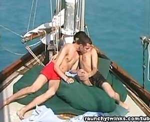 Matthew and Mikey's outdoor boat ride blowjob